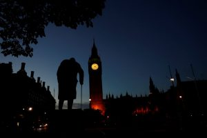 Dawn breaks behind the Houses of Parliament and the statue of Winston Churchill in Westminster, London, Britain June 24, 2016. REUTERS/Stefan Wermuth