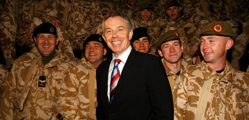 Britain's Prime Minister Tony Blair (C) visits British troops in Basra, southern Iraq December 17, 2006. REUTERS/Eddie Keogh/File Photo