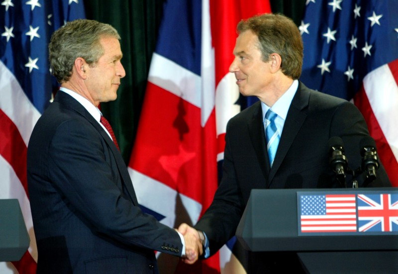 President George W. Bush and British Prime Minister Tony Blair shake hands after a joint press conference following their meeting at Hillsborough Castle near Belfast April 8, 2003. REUTERS/Kevin Lamarque/File Photo