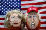 The images of Hillary Clinton and Donald Trump painted on decorative pumpkins created by artist John Kettman in LaSalle, Illinois. REUTERS/Jim Young