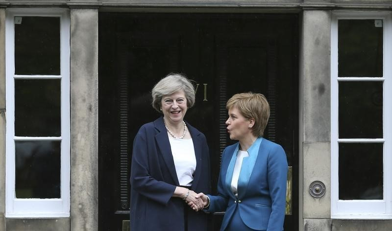 In happier days, Scotland's First Minister, Nicola Sturgeon (R), greets Britain's new Prime Minister, Theresa May, as she arrives at Bute House in Edinburgh, Scotland, Britain July 15, 2016. REUTERS/Russell Cheyne