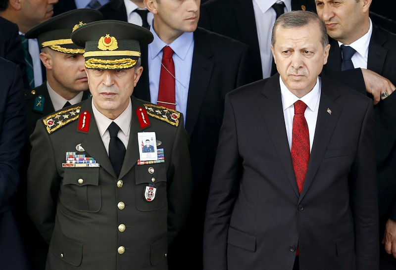 Turkish President Tayyip Erdogan (R) and Chief of Staff General Hulusi Akar attend a funeral ceremony for Army officer Seckin Cil in Ankara, Turkey, February 18, 2016. REUTERS/Umit Bektas/File Photo