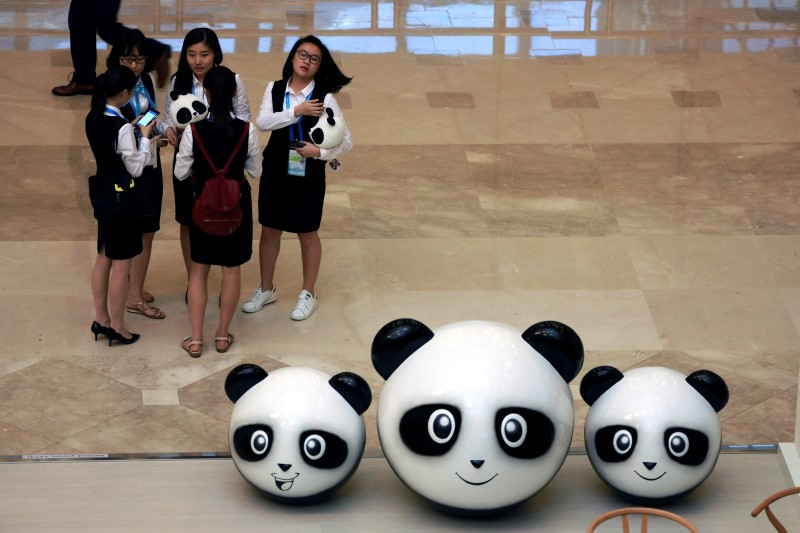 Chinese women gather near panda dolls  at the venue ahead of the G20 Finance Ministers and Central Bank Governors Meeting to be held over the weekend in Chengdu in Southwestern China's Sichuan province, July 22, 2016. REUTERS/Ng Han Guan/Pool