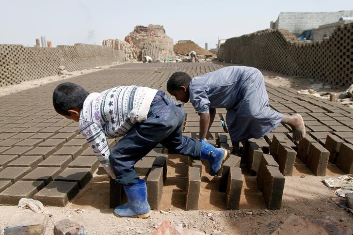 Boys arrange blocks at a brick factory on the outskirt of Sanaa, Yemen May 28, 2016. Picture taken May 28, 2016. REUTERS/Mohamed al-Sayaghi