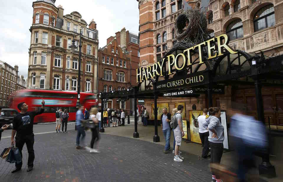People stand outside The Palace Theatre where the Harry Potter and The Cursed Child play is being staged, in London, Britain July 29, 2016. REUTERS/Peter Nicholls