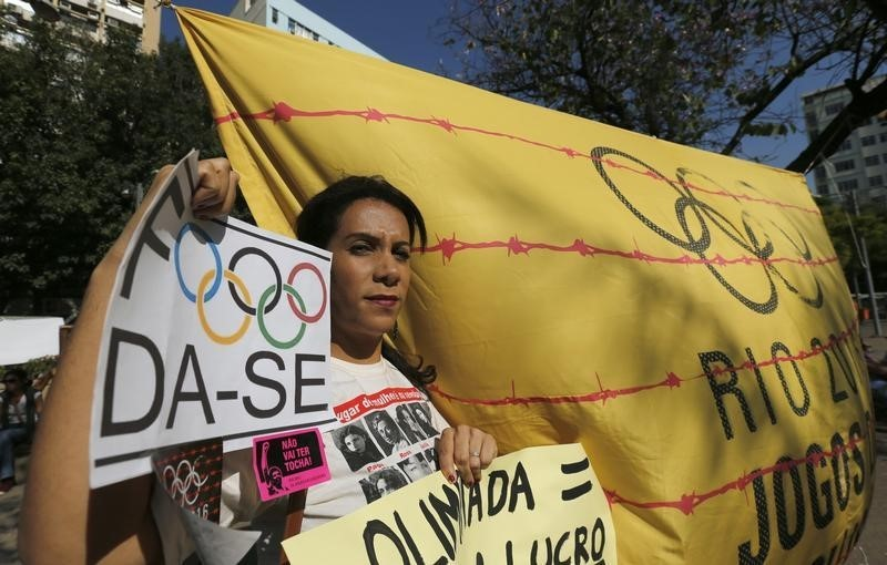 Dump the Olympics, writes Tom Regan in Commentary. Above, a woman attends a demonstration against the Olympic Games near the Maracana stadium ahead of the opening ceremony for the Rio 2016 Olympic Games in Rio de Janeiro, August 5, 2016. REUTERS/Sergio Moraes