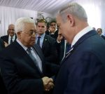 Israeli Prime Minister Benjamin Netanyahu shakes hands with Palestinian President Mahmoud Abbas (L) during the funeral of former Israeli President Shimon Peres in Jerusalem September 30, 2016. Amos Ben Gershom/Government Press Office (GPO)/Handout via REUTERS