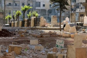 """A public garden converted to a graveyard due to overcrowding is pictured in the rebel held Salah al-Din neighbourhood of Aleppo, Syria October 6, 2016. The text on the grave reads in Arabic: """"Unknown, Salah allah."""" REUTERS/Abdalrhman Ismail"""