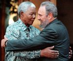 Former South African President Nelson Mandela (L) hugs Cuba's President Fidel Castro during a visit to Mandela's home in Houghton, Johannesburg in this September 2, 2001 file photo. REUTERS/Chris Kotze/File Photo