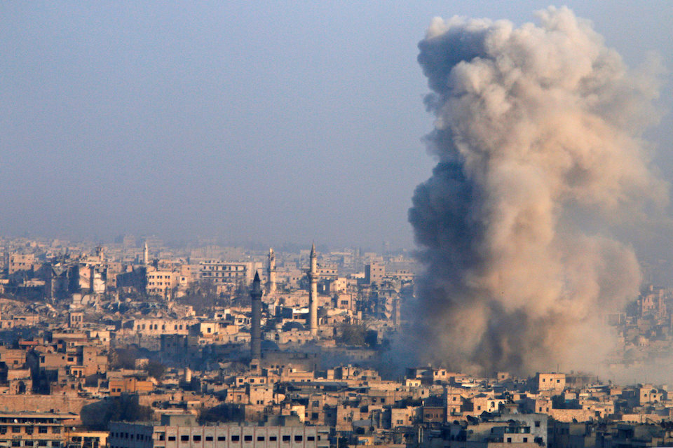 Smoke rises as seen from a governement-held area of Aleppo, Syria December 12, 2016. REUTERS/Omar Sanadiki