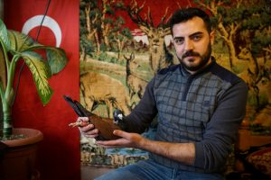 """Ismail Ozbek, 23, poses for a photograph with one of his pigeons in Sanliurfa, Turkey, December 10, 2016. REUTERS/Umit Bektas SEARCH """"PIGEONS AUCTION"""" FOR THIS STORY. SEARCH """"WIDER IMAGE"""" FOR ALL STORIES."""