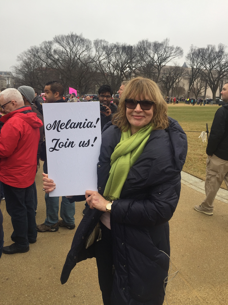 "Cheryl Hawkes and her sign, ""Melania! Join us!"""
