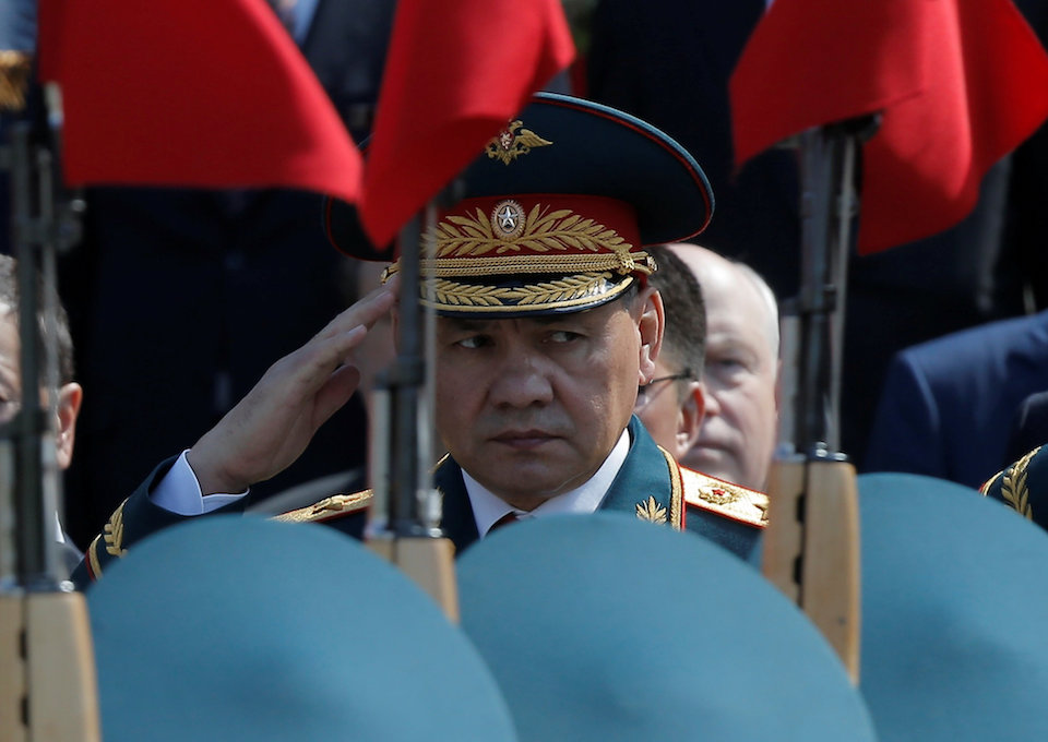 FILE PHOTO: Russian Defence Minister Sergei Shoigu watches honor guards passing by during a wreath-laying ceremony to mark the 71st anniversary of the victory over Nazi Germany in World War Two, at the Tomb of the Unknown Soldier by the Kremlin walls in Moscow, Russia May 9, 2016.  REUTERS/Maxim Shemetov/File Photo