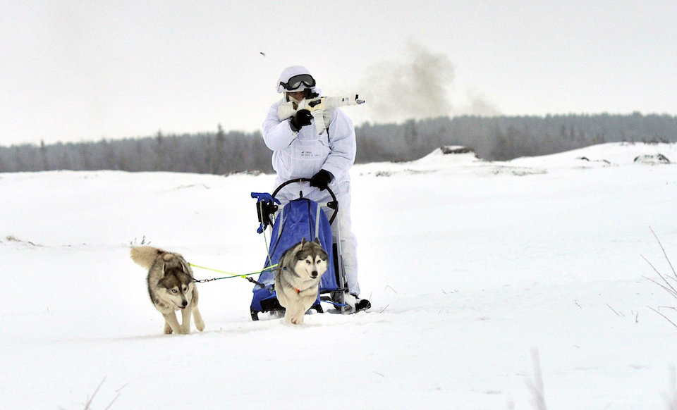 Russia's Military Buildup Focuses on Arctic. Above, a Russian serviceman of the Northern Fleet's Arctic mechanised infantry brigade participates in a military drill on riding reindeer and dog sleds near the settlement of Lovozero outside Murmansk, Russia January 23, 2017. Picture taken January 23, 2017. Lev Fedoseyev/Ministry of Defence of the Russian Federation/Handout via REUTERS