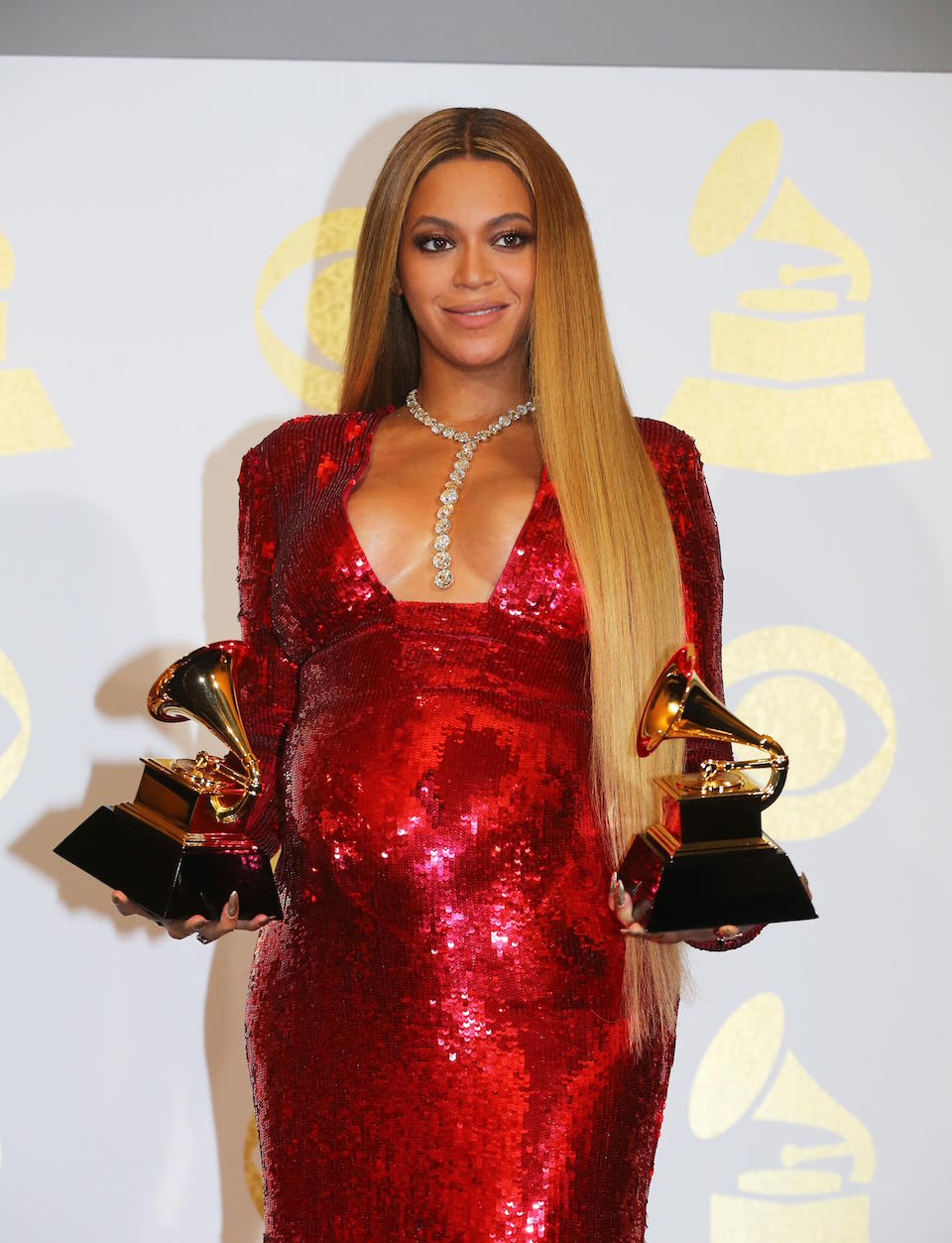 "Beyonce holds the awards she won for Best Urban Contemporary Album for ""Lemonade"" and Best Music Video for ""Formation"" at the 59th Annual Grammy Awards in Los Angeles, California, U.S. , February 12, 2017. REUTERS/Mike Blake"