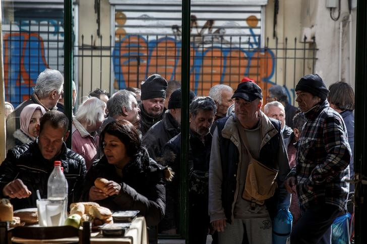 "People line up as they wait to enter a soup kitchen run by the Orthodox church in Athens, Greece, February 15, 2017. REUTERS/Alkis Konstantinidis            SEARCH ""POVERTY GREECE"" FOR THIS STORY. SEARCH ""WIDER IMAGE"" FOR ALL STORIES."