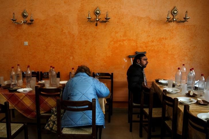 "People eat at a soup kitchen run by the Orthodox church in Athens, Greece, February 15, 2017. REUTERS/Alkis Konstantinidis            SEARCH ""POVERTY GREECE"" FOR THIS STORY. SEARCH ""WIDER IMAGE"" FOR ALL STORIES.    TPX IMAGES OF THE DAY"