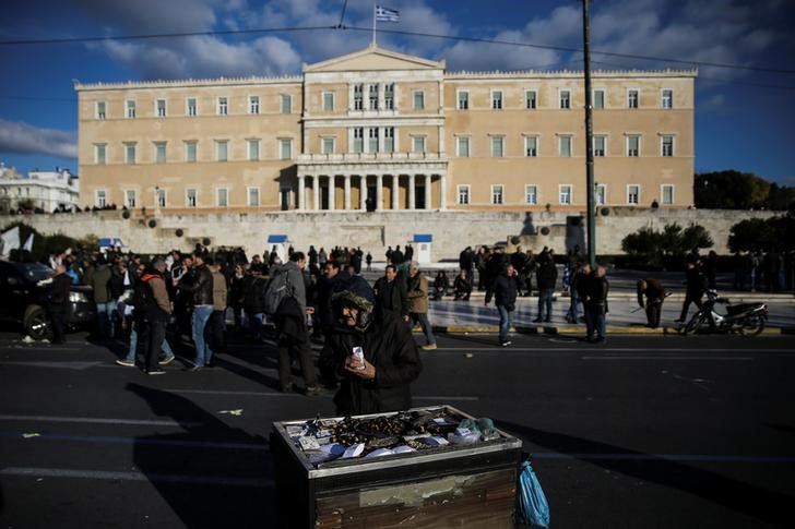 "An elderly man sells chestnuts in front of the parliament during a demonstration to demand tax reductions and compensation in Athens, Greece, February 14, 2017. REUTERS/Alkis Konstantinidis            SEARCH ""POVERTY GREECE"" FOR THIS STORY. SEARCH ""WIDER IMAGE"" FOR ALL STORIES."