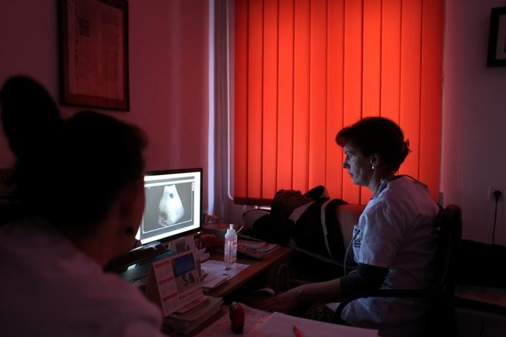 Doctor Gabriela Dromereschi does an ultrasound on a patient at her practice in Salistea de Sus, Romania January 4, 2017. REUTERS/Andreea Campeanu