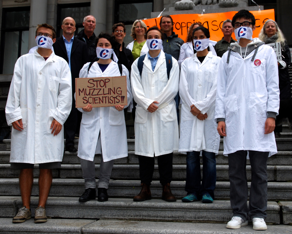 Scientists in Canada, supported by scientists around the world and global science journals, protested attempts to cut science funding and censor scientists from speaking out under Canada's Conservative government led by Stephen Harper, who was defeated in 2015. Above, scientists from the University of British Columbia and Simon Fraser University, in Vancouver, Canada, take part in a nation-wide protest in September, 2013.  © Deborah Jones 2013