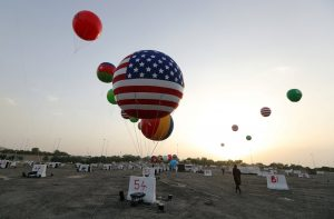 A worker walks past a balloon with a United States flag on it as part of welcome celebrations ahead of the visit of U.S. President Donald Trump, in Riyadh, Saudi Arabia May 19, 2017. REUTERS/Hamad I Mohammed