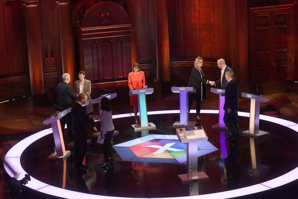 Liberal Democrat leader Tim Farron, Labour Party leader Jeremy Corbyn, Green Party co-leader Caroline Lucas, Plaid Cymru leader Leanne Wood, Interior Minister Amber Rudd, UKIP leader Paul Nuttall, SNP deputy leader Angus Robertson and moderator Mishal Husain attend the BBC's live televised general election debate in Cambridge, Britain, May 31, 2017. Jeff Overs/BBC Handout via REUTERS