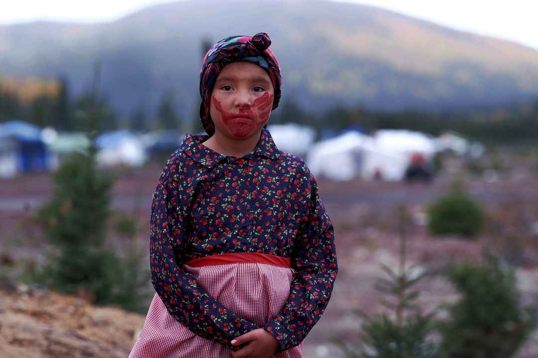 Chloe Benuen of the Innu First Nation in traditional costume after a ceremony at the annual Innu First Nations clan gathering at Gull Island, Labrador on the eve of Canada's Day of Reconciliation and Truth which is meant to honour the lost children and survivors of residential schools. Photo by Greg Locke