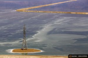 A utility pole stands in the Dead Sea