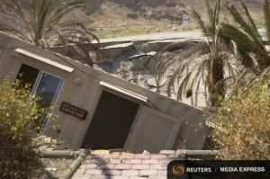 A structure that collapsed into a sinkhole is seen on shore of Dead Sea