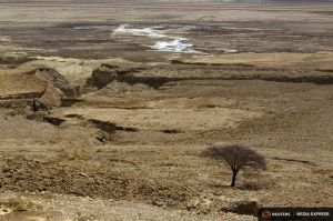 Sinkholes are seen on shore of Dead Sea