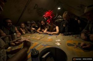 Enthusiasts play cards at the casino during Wasteland Weekend event in California City
