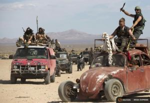 Enthusiasts ride their customized vehicles during the Wasteland Weekend event in California City