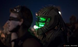 Enthusiasts watch a performance during Wasteland Weekend event in California City