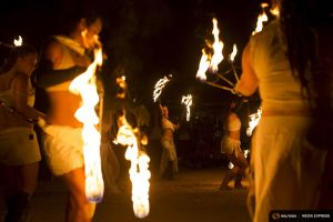 Fire dancers perform during Wasteland Weekend event in California City