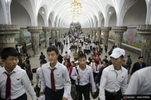 Commuters make their way through a subway station visited by foreign reporters during a government organised tour in Pyongyang