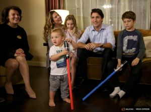 Liberal leader Justin Trudeau is accompanied by his mother, wife and children as he watches results at his election night headquarters in Montreal