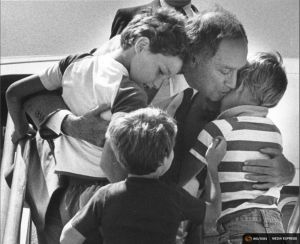 File photo of Canada's Prime Minister Pierre Trudeau greeting his sons Justin, Sacha and Michel after returning home from a foreign trip in Ottawa