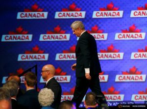 Canada's Prime Minister Stephen Harper walks off the stage after giving his concession speech following Canada's federal election in Calgary