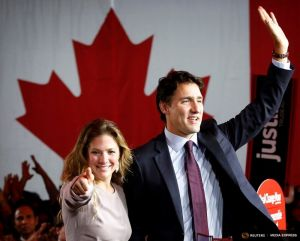 Liberal Party leader Justin Trudeau waves while accompanied by his wife Sophie Gregoire as he gives his victory speech after Canada's federal election in Montreal