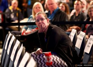 A Conservative Party supporter reacts as she watches results of Canada's federal election in Calgary