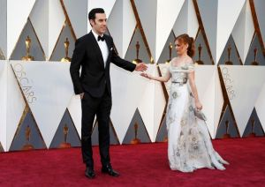 Presenter Sacha Baron Cohen and wife Isla Fisher arrive at the 88th Academy Awards in Hollywood