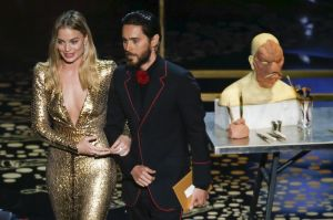 Presenters Margot Robbie and Jared Leto take the stage to present the award for Best Makeup and Hairstyling at the 88th Academy Awards in Hollywood, California