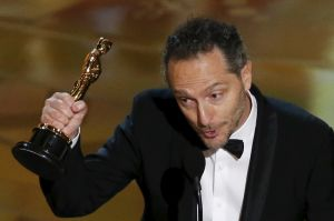 Mexican cinematographer Emmanuel Lubezki holds his Oscar for Best Cinematography for the movie