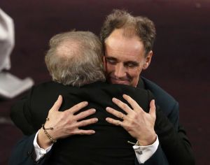 Rylance embraces director Spielberg after Rylance received the Oscar for Best Supporting Actor for the movie